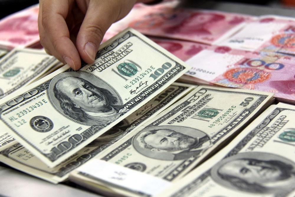 الدولار يرتفع مقابل اليوان الصيني وسط تهديدات بفرض رسوم أمريكية اقتصادي