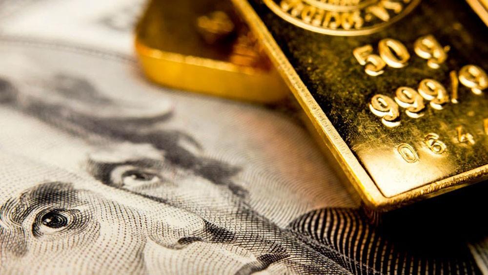 الذهب يتجاوز 1400 دولار مع تراجع العملة وعوائد السندات